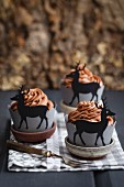 Cupcakes in paper cases decorated with deer