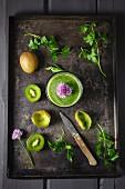 A kiwi smoothie with herbs