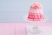 Minikuchen mit rosa Icing-Dekor
