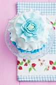 A mini cake with light blue icing