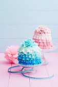 Pink and light blue mini cakes