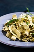 Wild garlic tagliatelle garnished with wild garlic