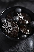 Liquorice laces and salty liquorice pearls in a bowl