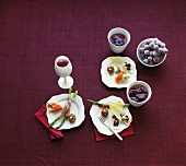 Various appetisers featuring grapes and drinks