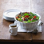 Mixed salad leaves with tomatoes and olives