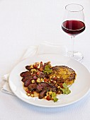A hanger steak with a bean salsa and a glass of red wine