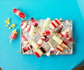 Homemade ice lollies on tray of ice cubes