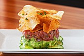 Avocado and tuna tatar with potato chips