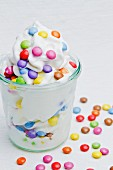 Frozen yogurt with colourful chocolate beans