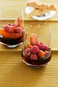 Raspberries and peaches in red wine