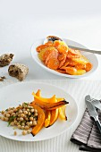 Carrot and orange salad and chickpea salad with oven-roasted vegetables