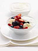 Yoghurt muesli with fresh berries and bananas