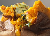 Baked sweet potatoes with herb butter