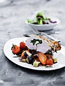 Turkey breast on a bed of summer vegetables