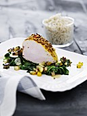 Five-spice turkey breast on a bed of spinach