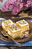 Amaretto slices garnished with lilac flowers