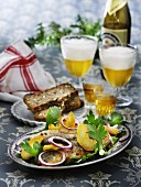 Fried herring with apples and onions served with Aquavit and beer (Scandinavia)
