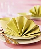 A decoratively folded napkin on a plate