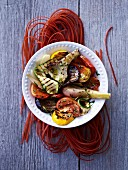 Grilled vegetables on raw beetroot pasta