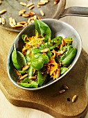 Mange tout salad with basil and pine nuts