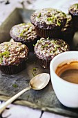 Chocolate muffins decorated with icing sugar and lime zest and served with an espresso