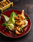 A mussel skewer with bok choy