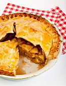 Apple pie, partly sliced