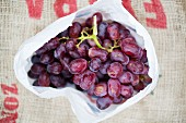 Red grapes in a plastic bag