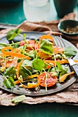 Water cress salad with vegetables and citrus fruits