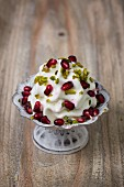 Frozen yogurt with chopped pistachios and pomegranate seeds