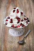 Frozen yogurt with pomegranate seeds