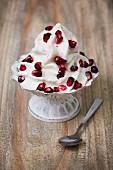 Frozen yogurt with pomegranate seeds