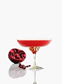 A pomegranate drink in a champagne glass