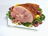 Roast ham with sugared grapes and parsley