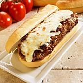 A meatball and mozzarella baguette