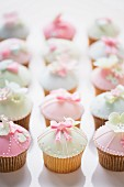 Pastel coloured cupcakes for a baby shower