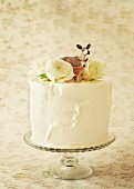 Carrot cake with cream cheese decorated with a deer figure