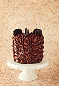 A chocolate cake with Oreo cookies