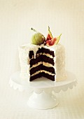 A coconut cake with fresh figs, sliced