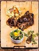 Veal steak with a wild herb salad and mashed potatoes