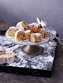Mini stollen on a cake stand with a silver base