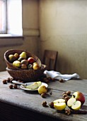A rustic arrangement of apples and nuts on a wooden table