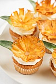 Cupcakes decorated with dried pineapple chips