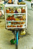 Street food in a chilled display cabinet on a bicycle at a market in Saigon (Vietnam)