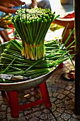 Fresh spring onions at a market in Saigon (Vietnam)