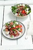 Rocket salad with strawberries, Camembert, Proscuitto and red onions