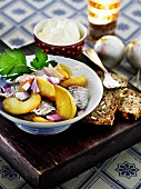 Herring salad with apple and onion for Christmas