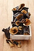 Dried aubergines in a wooden box