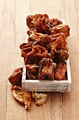 Dried peppers in a wooden box
