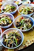 Vietnamese mushroom salads in plastic bowls